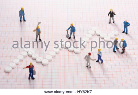 Working men creating medical system growth - Stock Photo