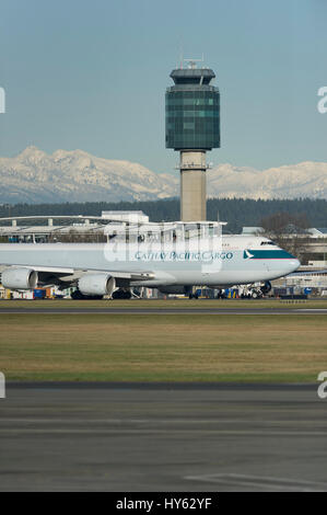 Cathay Pacific Cargo Boeing 747 taxiing in front of YVR control tower, Vancouver International Airport. - Stock Photo