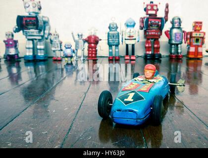 old tin racing car on wooden floor - Stock Photo