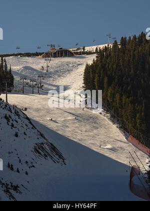 Mass downhill skiing on Todorka mountain, Bansko ski  resort, Bulgaria - Stock Photo