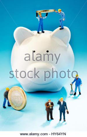 Working men creating cash for investment - Stock Photo