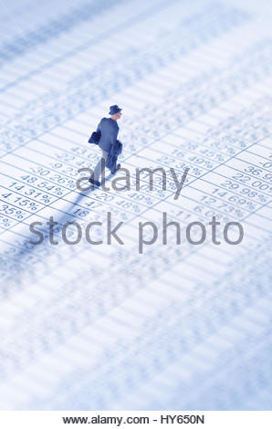 Businessman playing the stock market - Stock Photo