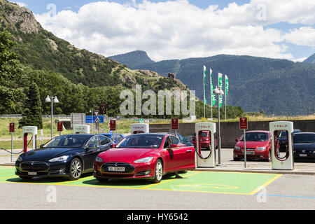 MARTIGNY, SWITZERLAND - JUNE 29, 2016: Two Tesla model S cars charging their battery with the Tesla supercharger - Stock Photo