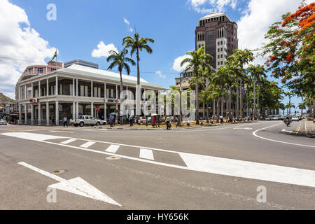 PORT LOUIS, MAURITIUS - NOVEMBER 18, 2016: People walk in the street of Port Louis lined with international banks - Stock Photo