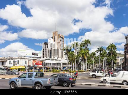 PORT LOUIS, MAURITIUS - NOVEMBER 18, 2016: Cars drive in the modern business center of Port Louis, Mauritius capital - Stock Photo