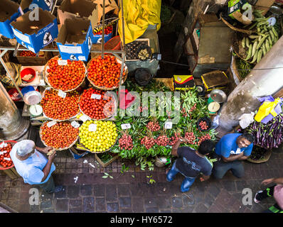PORT LOUIS, MAURITIUS - NOVEMBER 18, 2016: People shops for fresh fruits and vegetables in the traditional fresh - Stock Photo