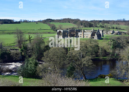 Egglestone Abbey and River Tees near Barnard Castle, seen from the B road high above the river. - Stock Photo