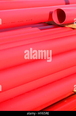 red plastic pipes - Stock Photo
