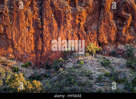 Red rock formations at Glen Helen Gorge in Northern Territory Central Australia - Stock Photo
