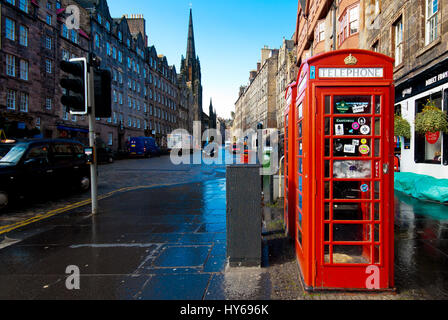 View of Edinburgh (Scotland) street and the red telephone booth in front. - Stock Photo