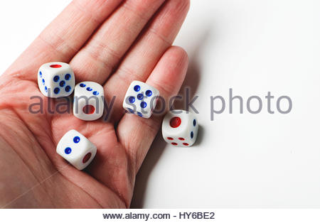 Hand throwing dice on white background. Isolated. - Stock Photo