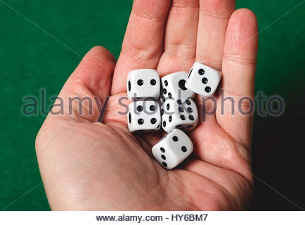 White dice on a hand. Isolated. - Stock Photo