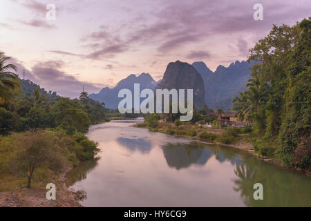 Beautiful sunrise over the Nam Song river near the Vang Vieng village, Laos - Stock Photo