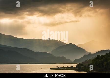 Beautiful sunset sky over the Phewa Lake in Pokhara, Nepal - Stock Photo