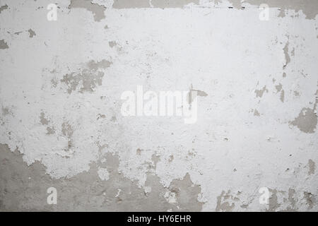 old wall background,  peeling  white paint - Stock Photo
