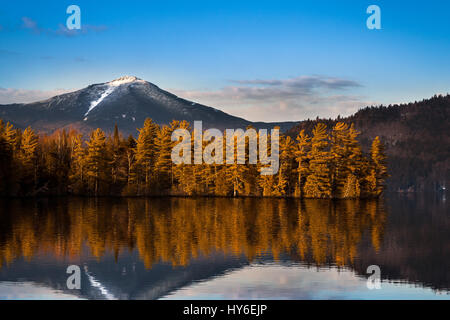 Snowy Whiteface mountain with reflections in Paradox Bay, Lake Placid, Upstate New York - Stock Photo