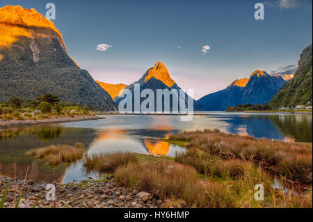 Dawn at Milford sound, Fiordlands National Park, New Zealand - Stock Photo