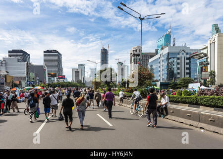 JAKARTA, INDONESIA - DECEMBER 18, 2016: People enjoy outdoor activities, including street food, during the car free - Stock Photo