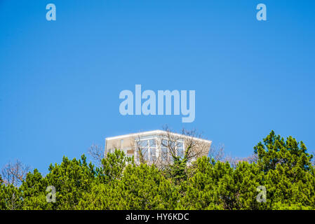 New single white house on a blue sky copyspace - Stock Photo