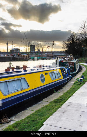 Narrowboats moored on Regent's Canal at King's Cross, London, UK, redevelopment works in the background, 2012 - Stock Photo