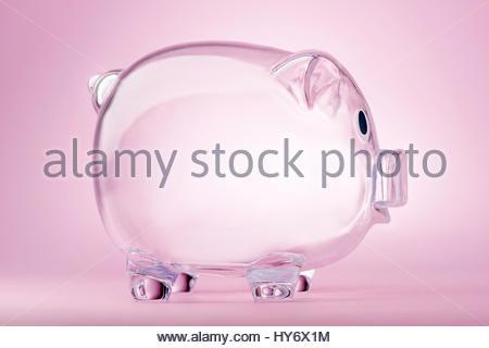 Empty transparent piggy bank on pink background - Stock Photo
