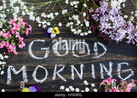 Words Good Morning with Spring Flowers on a Rustic Wooden Background. - Stock Photo