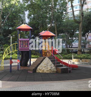 empty children's playground in a park in Kowloon, Hong Kong - Stock Photo