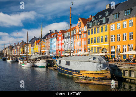 Nyhavn is a colourful 17th century waterfront, canal and popular entertainment district in Copenhagen, Denmark. - Stock Photo