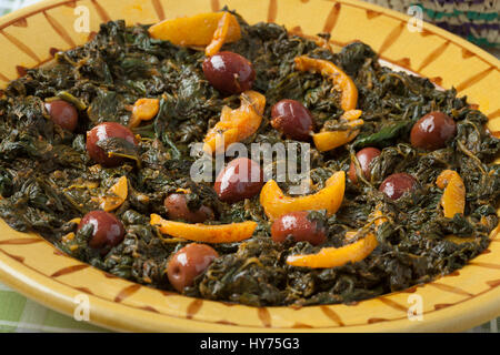 Traditional Moroccan dish with spinach, olives and preserved lemon close up - Stock Photo