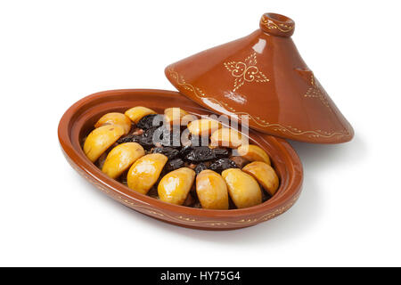 Traditional Moroccan festive oval tajine with meat, quinces and prunes isolated on white background - Stock Photo
