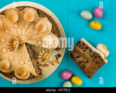 Easter Simnel Cake With Marzipan Icing and Decorations Against a Blue Background - Stock Photo
