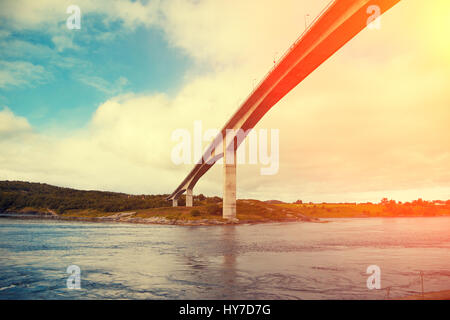 Bridge over fjord at sunset. Whirlpools of the maelstrom of Saltstraumen, Norway - Stock Photo