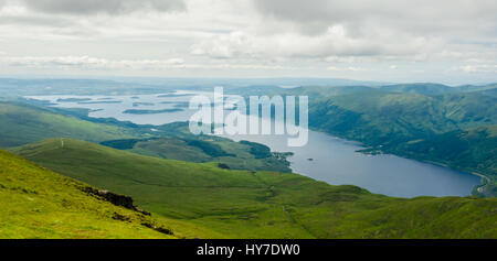 View of Loch Lomond a freshwater Scottish loch from the top of Ben Lomond in a sunny day. Scotland (UK). - Stock Photo