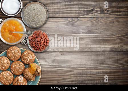 Protein muffins, sugar free apricot jam, bran, sweetener top view - Stock Photo