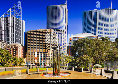 Tall skyscrapers on the streets of Sydney behind memorial fountain at the Royal Botanic Garden in city downtown - Stock Photo