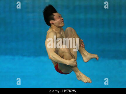 Kazan, Russia. 1st Apr, 2017. China's Yuan CAO competes to win the men's 3m springboard final at the 2017 FINA/NVC - Stock Photo