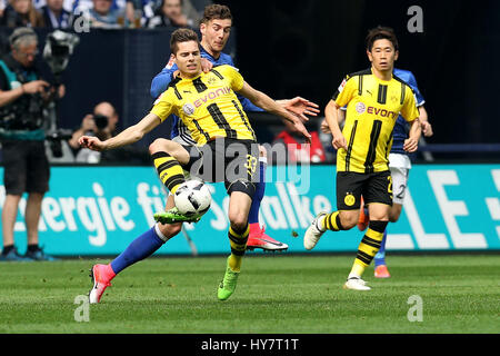 Gelsenkirchen. 1st Apr, 2017. Leon Goretzkai (R2) of FC Schalke 04 vies with Julian Weigl (L) of Borussia Dortmund - Stock Photo