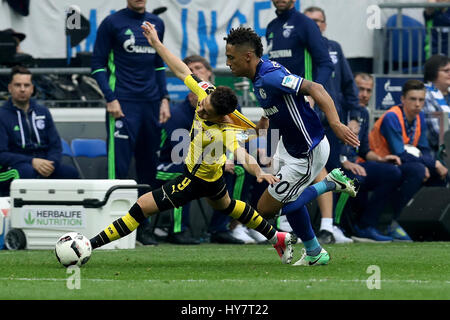 Gelsenkirchen. 1st Apr, 2017. Thilo Kehrer (front R) of FC Schalke 04 vies with Emre Mor (L) of Borussia Dortmund - Stock Photo