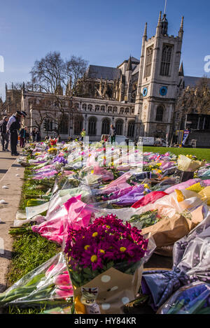 Floral tributes to PC Keith Palmer and the others killed by terrorist action outside Parliament in Westminster, - Stock Photo