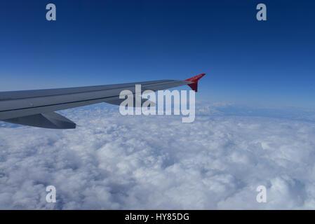 Airplane air Berlin clouds, Flugzeug Air Berlin Wolken - Stock Photo