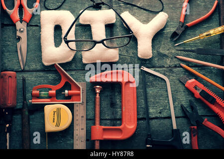 Diy tools background with group of crafting tools like scissors, hammer, knife, equipment for handmade product on - Stock Photo