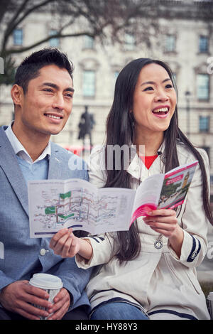 A young Japanese couple sightseeing in London - Stock Photo