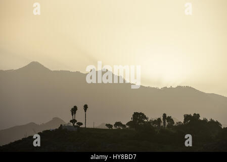Sunset and fog in the mountains landscape - Stock Photo