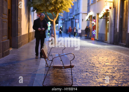 Senior people walking in narrow streets of Las Palmas - Stock Photo