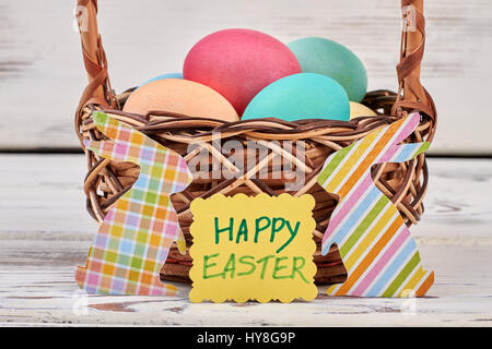 Happy Easter card, egg basket. Colorful paper rabbit cutouts. - Stock Photo