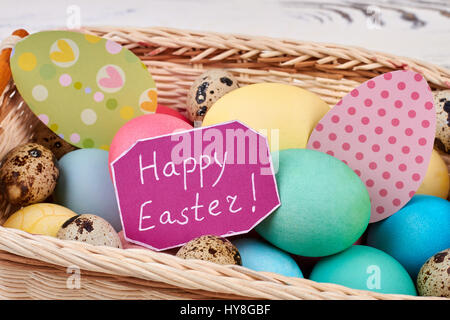 Greeting card and Easter basket. Eggs and colorful paper cutouts. Tips for Easter. - Stock Photo
