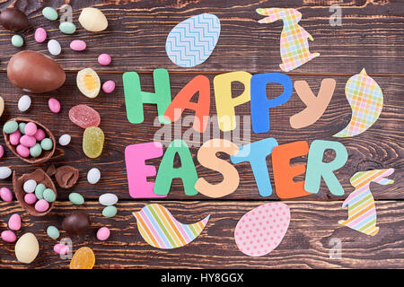 Candies and Easter paper decorations. Bright colored cutouts. Art and craft handmade. - Stock Photo