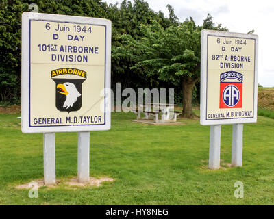Sainte Mere Eglise, France - At the entrance of Sainte Mere Eglise town, in Normandy, two panels honor the memory - Stock Photo