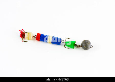 Exhibition of self-made fishing metal lures. Bait for fishing in the shape of a spoon with a hook on a white background. - Stock Photo
