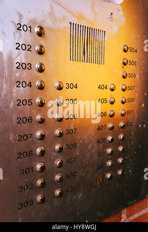 Old weathered intercom button panel, selective focus - Stock Photo